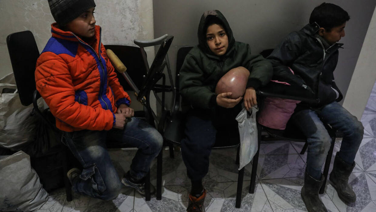 Ten-year-old cancer patient Zuhair (C), who had his leg amputated because of the disease, waits for an ambulance inside the SARC center of Douma during medical evacuations from eastern Ghouta to Damascus, Syria, 27 December 2017 Fot. PAP/EPA/MOHAMMED BADRA