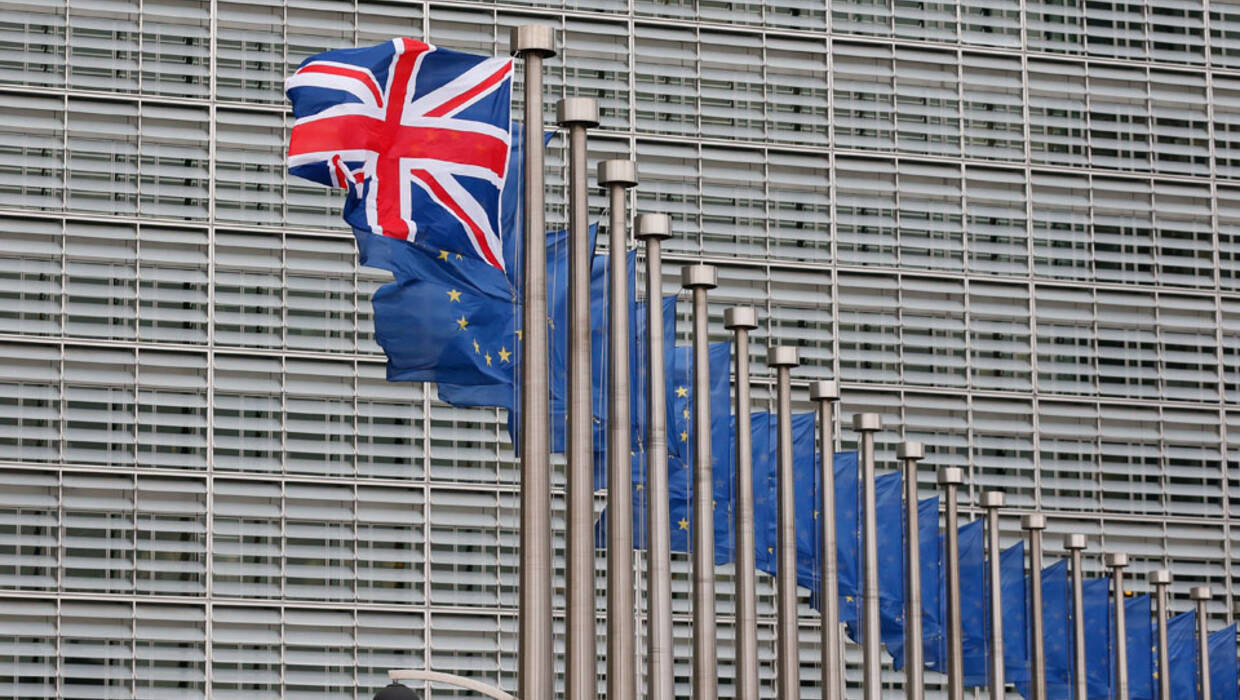 A Union Jack flag flutters next to European Union flags ahead a visits of the British Prime Minister David Cameron at the European Commission in Brussels, Belgium, 29 January 2016. Cameron arived in Brussels for unscheduled talks on a Brexit referendum. Fot. EPA/LAURENT DUBRULE