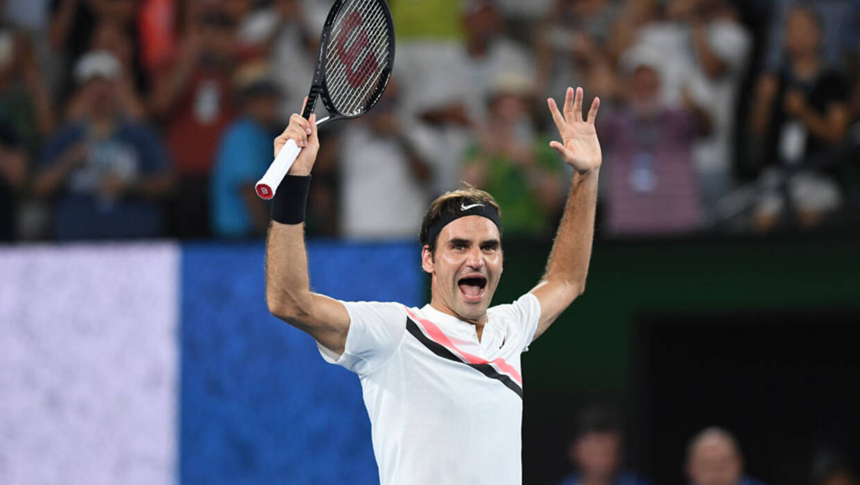 epa06480729 Roger Federer of Switzerland celebrates winning his men's final match against Marin Cilic of Croatia at the Australian Open Grand Slam tennis tournament in Melbourne, Australia, 28 January 2018. EPA/LUKAS COCH AUSTRALIA AND NEW ZEALAND OUT PAP/EPA/LUKAS COCH