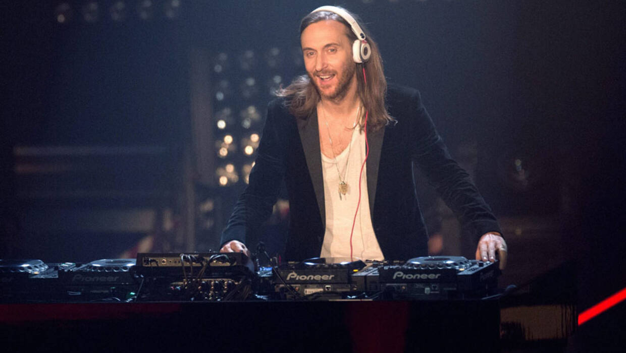 "epa04526965 French DJ David Guetta performs during the final of ""The Voice of Germany"" in Berlin, Germany, 12 December 2014.  EPA/Jorg Carstensen  Dostawca: PAP/EPA. Archiwum PAP/EPA © 2016 / Jorg Carstensen"
