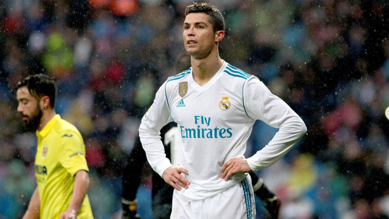 16ed6dbc0 Real Madrid's Portuguese forward Cristiano Ronaldo (C) reacts against  Villarreal FC during the Primera