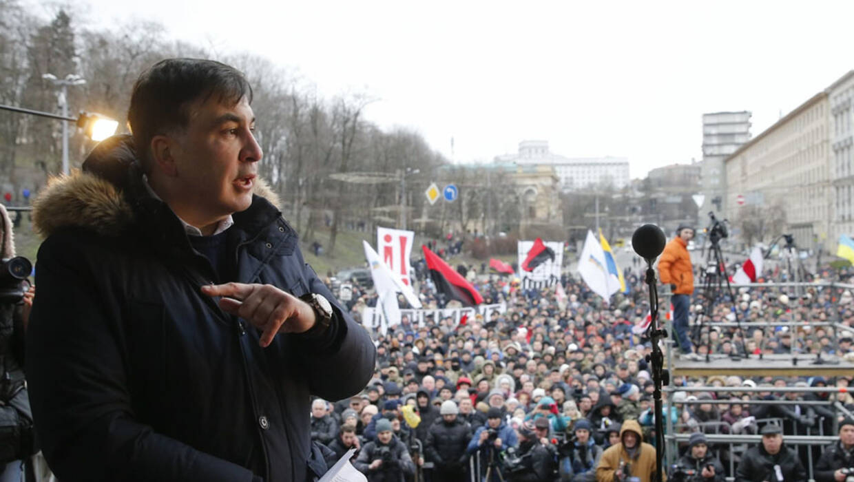 epa06495931 Mikheil Saakashvili speaks on a podium during their rally in downtown Kiev, Ukraine, 04 January 2018. Protesters, supporters of the  Former Georgian president and ex-Odessa Governor Mikheil Saakashvili, are demanding the Ukrainian parliament to accept a law about the impeachment of President. Public protests continuing since 17 October 2017 with demanding from Ukrainian lawmakers lifting of their parliamentary immunity, modification of the electoral legislation, as well as the establishment of an Anti-Corruption Court.  EPA/SERGEY DOLZHENKO  Dostawca: PAP/EPA. PAP/EPA © 2018 / SERGEY DOLZHENKO
