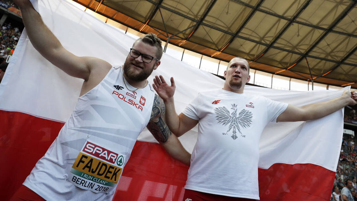 Wojciech Nowicki (R) and Pawel Fajdek of Poland celebrate after winning gold and silver respectively in the men's Hammer Throw final at the Athletics 2018 European Championships in Berlin, Germany, 07 August 2018.   Fot. PAP/ EPA/CHRISTIAN BRUNA